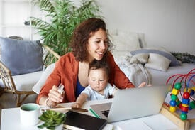 Woman working with baby on her lap