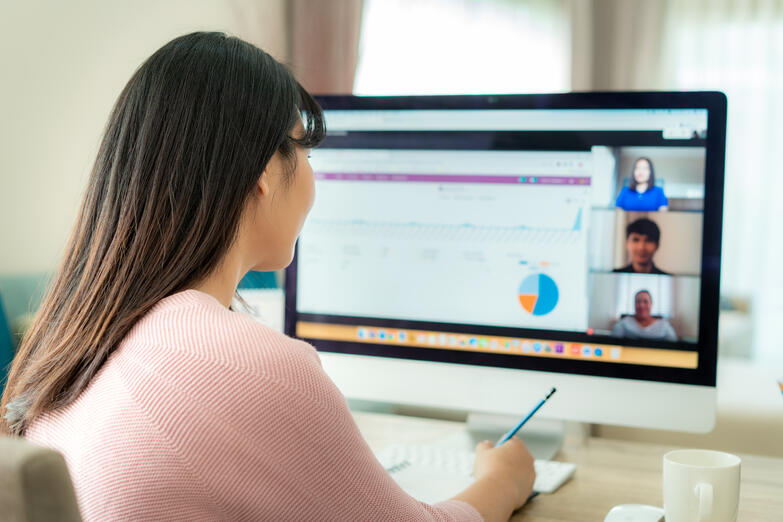 Woman working remotely on video call