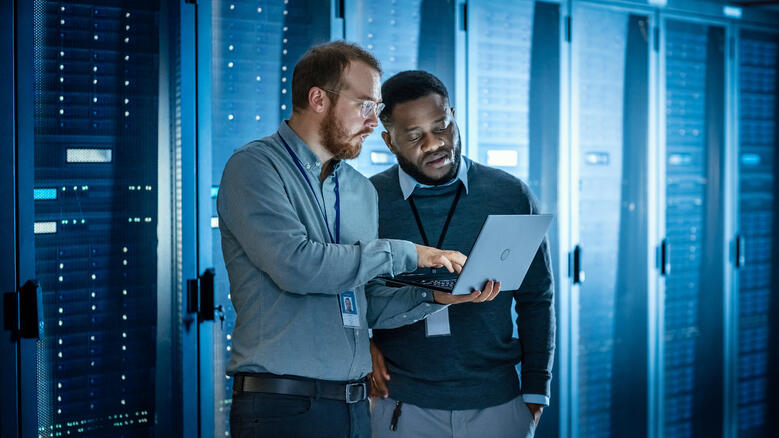 Two men in a data centre