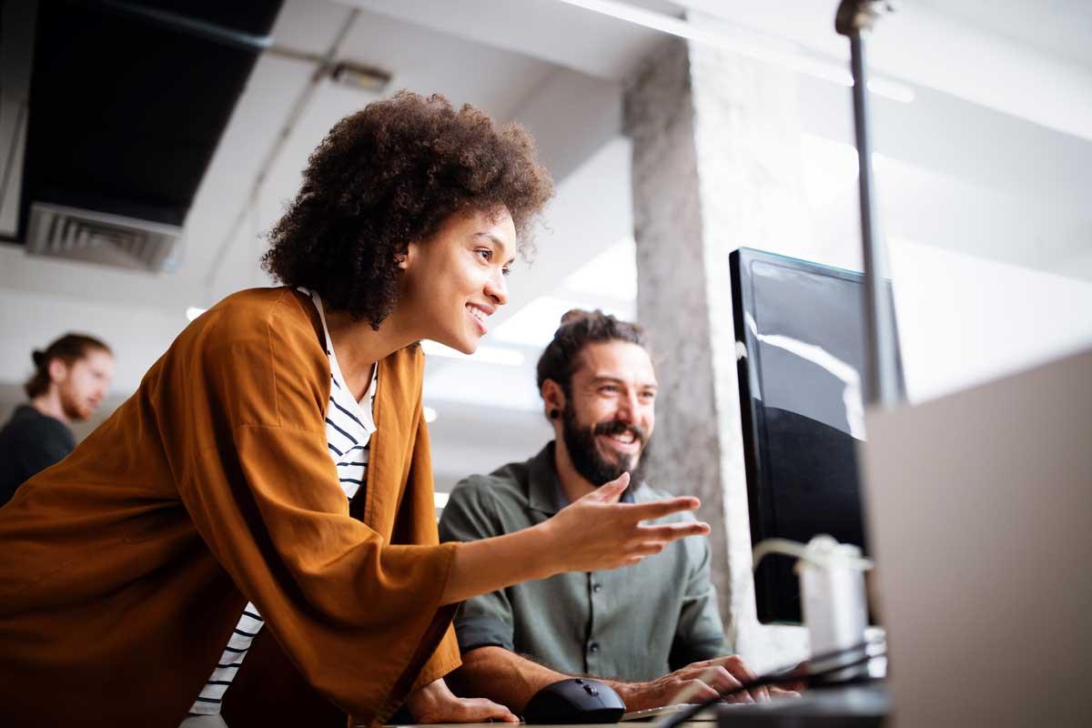 Woman and man look at a computer screen