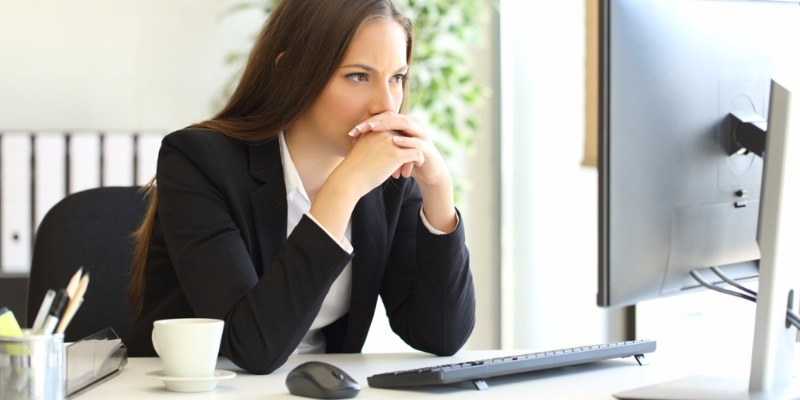 businesswoman-pondering-over-difficult-assignment.jpg